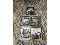 Five PS3 games with original booklets