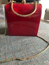 Red patent bag