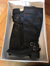 Clarks black, real leather, long buckle boot.