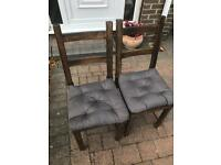 Dark wood chairs with grey cushions