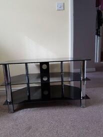 Black glass & chrome legged TV stand