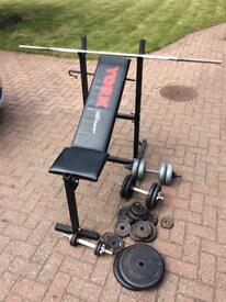 Weight bench, barbell and selection of weights