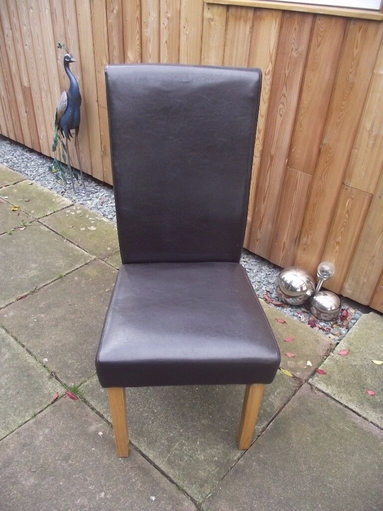 2 x Chocolate brown faux leather dining chairs with light oak colour legs