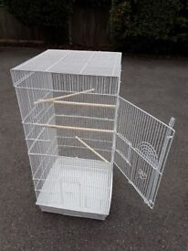White bird cage with accessories-4 feeder bowls, a swing, a perch cover, etc.