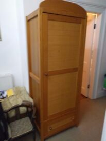 Solid wooden wardrobe with shelving and drawer