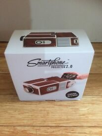 Smartphone Projector 2.0 - cinema in a box! Unwanted gift - not used.