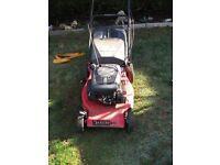 Champion self propelled lawnmower 18 inch cut