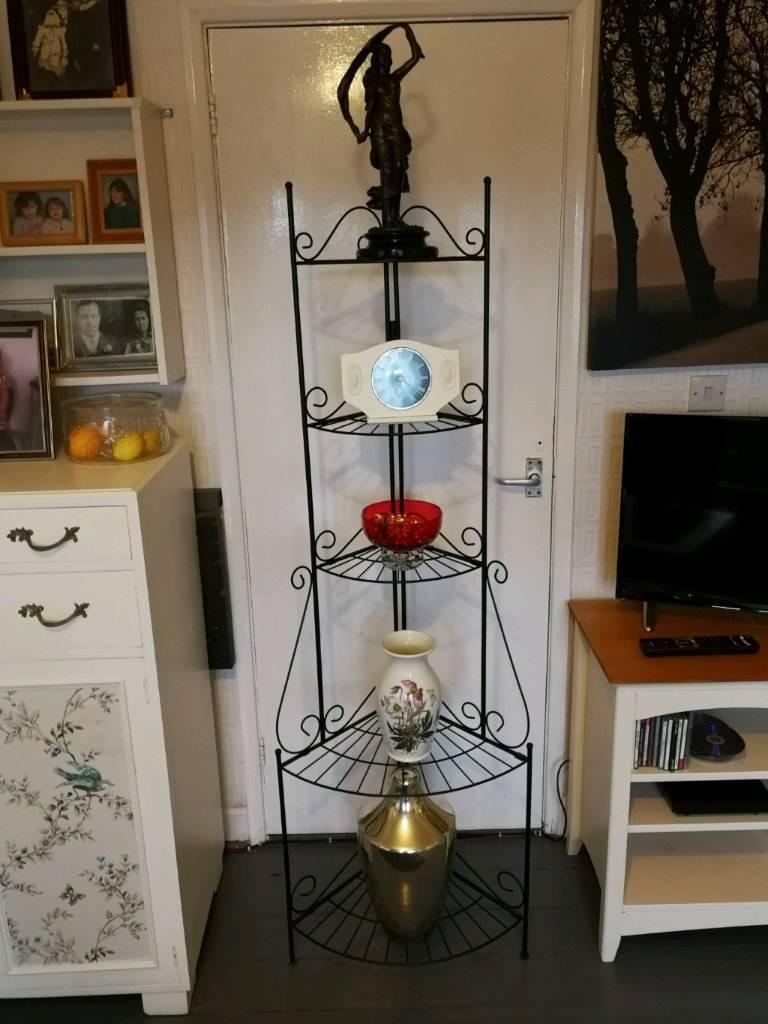Black iron fold up corner ornament stand.