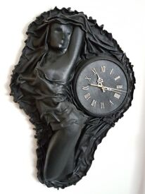 Collectible,modern art, handcrafted sculpture clock in black leather.