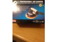 Hand held palm air sander , in the box with tools and instruction booklet