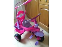 Pink/purple trike with canopy