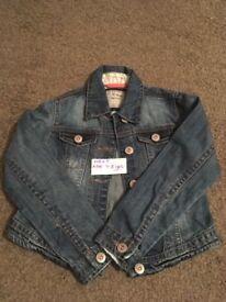 Girls Next denim jacket. Age 7-8 Years