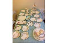 Mismatched vintage tea set with milk jug, sugar bowl and cake stand