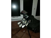 Full set of adult right hand golf clubs + bag + balls + tees + trolley. Perfect for a starter.