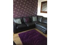 Brown leather corner sofa with matching armchair