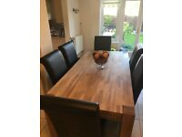 Solid Oak dinning table and 6 oak/leather chairs