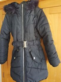 Girls Navy Blue school coat size 9-10. Fur inside and around the hood. Good condition.