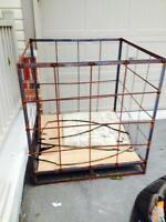 Steel cage with wood pallets
