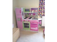 Lovely Kidcraft wooden Play Kitchen with lots of play food and dishes