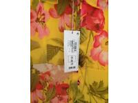 A designer maxi dress new with tags on