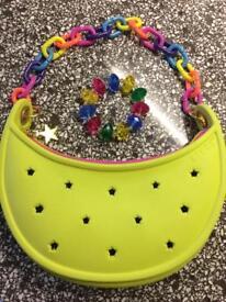 Crocs brand handbag with colourful matching bracelet.