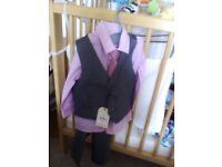 Suit 12-18 months unused