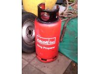 Calor gas, 18kg propane red cylinder, weighs 34kg,, quite full