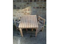 Childs pine slated table and 2 chairs