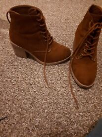 brown suede boot heels. very comfortable, worn a few times.