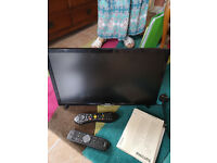 Fully functional TV with remotes and instructions