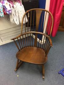 Dark wood Ercol rocking chair