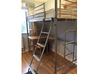 Metal bed with desk and chair. Ideal for teenage bedroom as gives space to sleep and study.