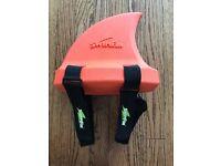 Swim fin swim training device