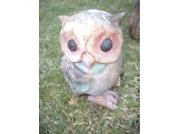 A OLD WOODEN OWL GARDEN ORNIMENT 7X4X4 INCHES