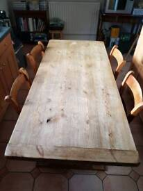 Wooden farmhouse kitchen table with 4 chairs.