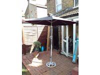 Black garden parasol with base