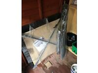 Square glass table and parasol. Never used