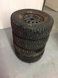 4 Firestone winter tires with rims:235/70R16
