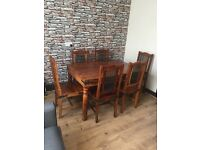 Hardwood dinning table and six chairs
