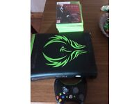 Xbox 360 with cables and 12games and 1 controller