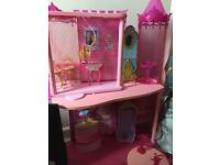 Barbie house with working lift.