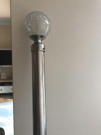 Chrome curtain pole