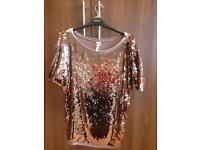 Next sequin top.