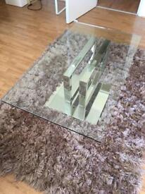 Glass centre table with chrome bottom