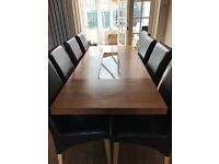 Solid wood 8 seater table and 8 chairs