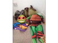 Kids dressing up ninja turtles gruffalo dinosaur