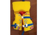 Infant/ Child life jacket in yellow. Less than 50lbs/ 23kgs