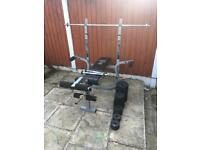 Bench with weights Set Dumbbells Barbell. Can deliver.