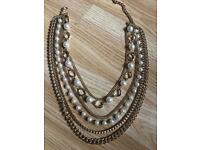 Gold multi chain necklace with pearls