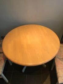 Circular wooden dining table and 4 chairs